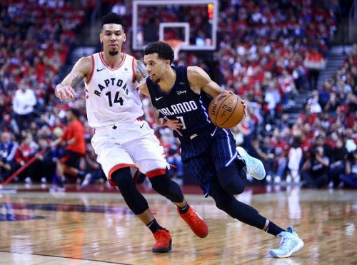 Toronto's Danny Green chasing Michael Carter-Williams of the Orlando Magic during Game One