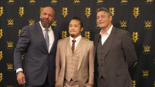 KUSHIDA with Triple H and William Regal