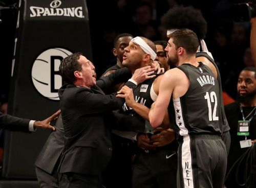 Jared D'Angelo Russell Joel Embiid and Jarrett Allen scampering for the ball Dudley being held back after the 3rd quarter scuffle
