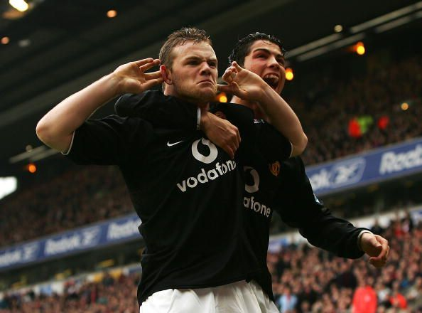 Ronaldo celebrating with Rooney in a Premier League meeting between Liverpool & Manchester United.