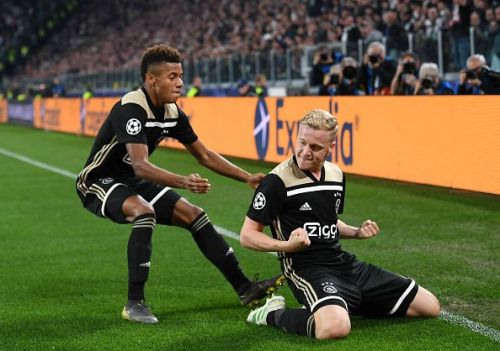 van de Beek (right) celebrates his goal with David Neres during a memorable second leg in Turin
