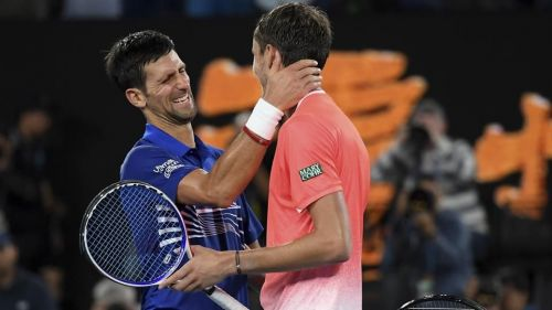 Novak Djokovic and Daniil Medvedev after their fourth round match at the Australian Open 2019.