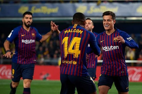 Malcom celebrates with Coutinho after creating his second La Liga assist