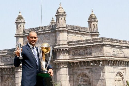 Dhoni posing with the World Cup trophy in Mumbai
