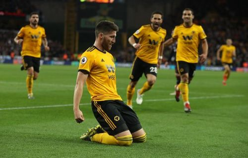 Wolverhampton Wanderers players celebrating a goal against Arsenal FC at Molineaux Stadium