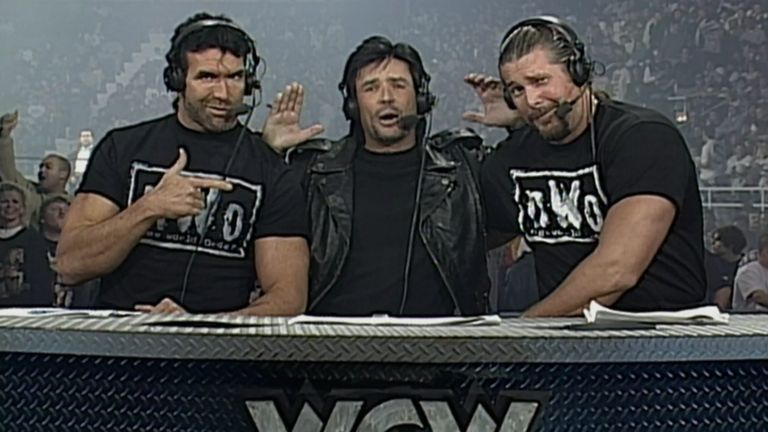Eric Bischoff, flanked by Scott Hall and Kevin Nash