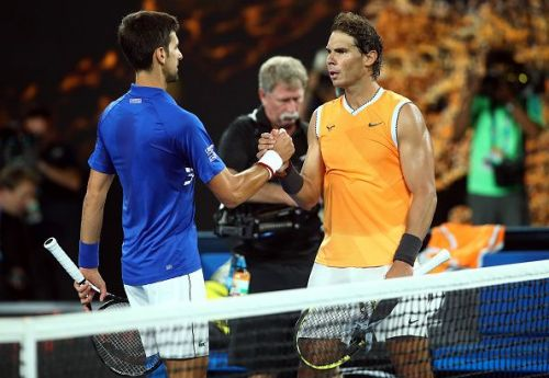 Nadal congratulates Djokovic after the former slumped to his worst ever defeat in a Grand Slam final