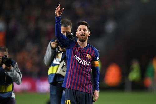 Lionel Messi celebrates Barcelona's title triumph