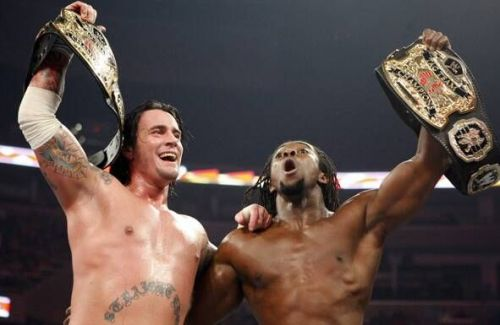 CM Punk and Kofi Kingston were tag-team champions once upon a time.