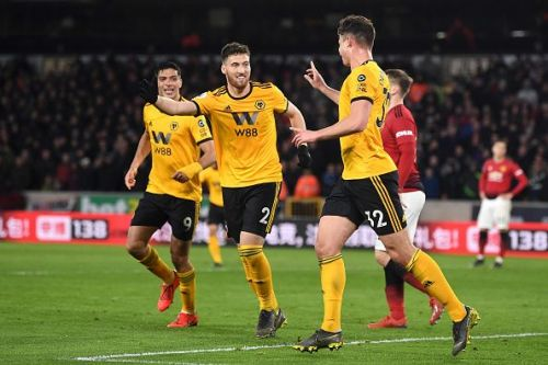 Wolves players celebrate after the second goal