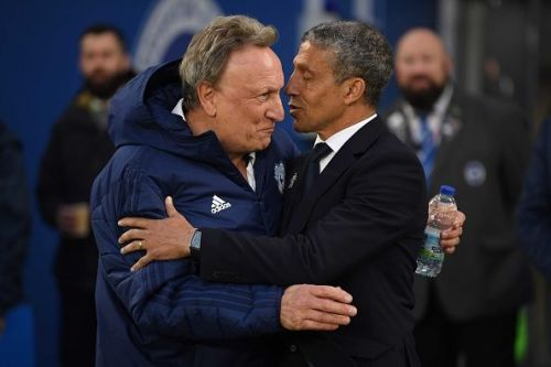 Neil Warnock and Chris Hughton embracing each other before kick-off at the American Express Community Stadium.