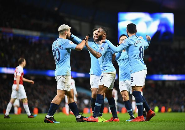 Six Manchester City players are in the XI