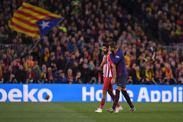 Costa is consoled by compatriot Pique after receiving a straight red card for dissent