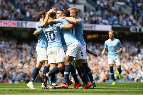 Manchester City players celebrate after Phil Foden's goal against Tottenham Hotspur during their Premier League match at the Etihad Stadium on Saturday