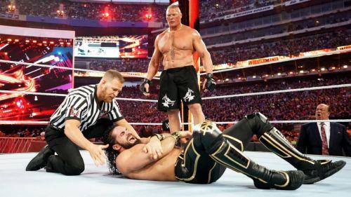 Lesnar punishing Rollins at WrestleMania!
