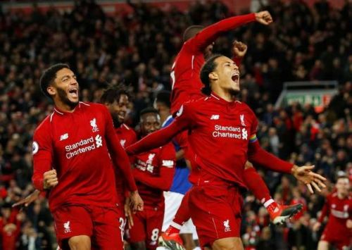 Liverpool defender Virgil Van Dijk celebrates as Liverpool score a 93rd minute winner against city rivals Everton
