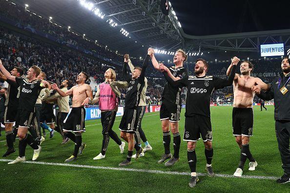 Exuberant Ajax players celebrating their quarter-final victory against Juventus.