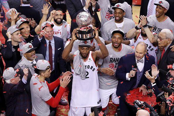 Kawhi Leonard holds the Eastern Conference Finals Trophy