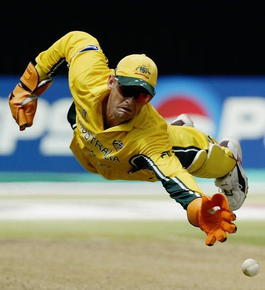 Adam Gilchrist of Australia dives for the ball