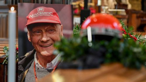 Lauda's famous red race helmet was placed above his coffin