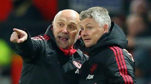 Mike Phelan (left) and Ole Gunnar Solskjaer, along with Michael Carrick, can bring back the glory days at Old Trafford