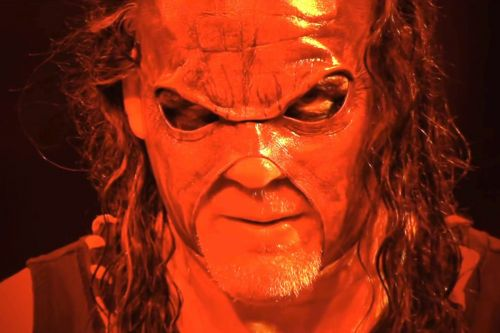 Kane made surprise return and choke slammed a guy through a table.