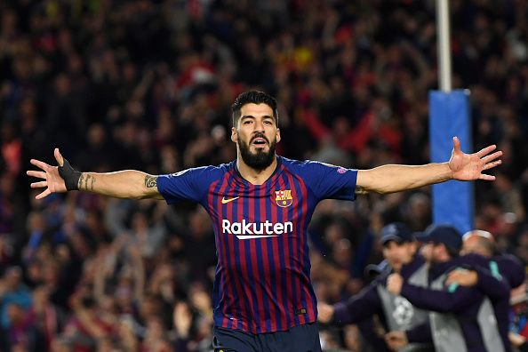 Luis Suarez celebrating after scoring against his former club Liverpool.