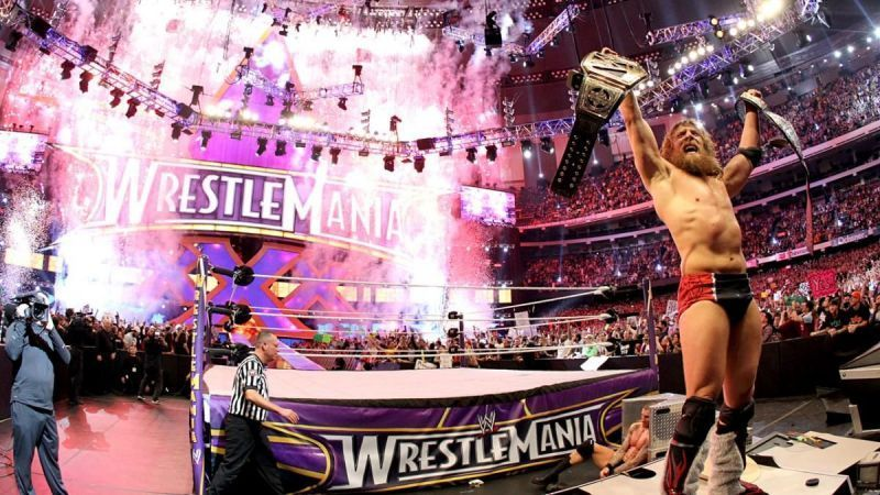 Daniel Bryan celebrating after winning the WWE World Heavyweight Championship in the main event of WrestleMania 30