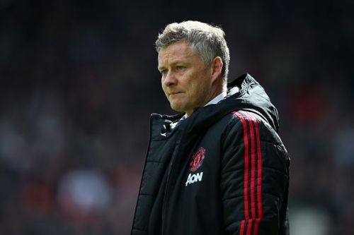 Ole watches the game from the sidelines as United misses out on a win.
