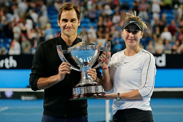 Roger Federer and Belinda Bencic after winning the 2019 Hopman Cup in Perth, Australia