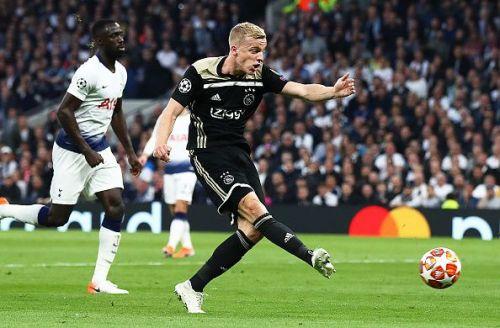 Ajax's van de Beek scores the only goal of the game as Tottenham players look on.