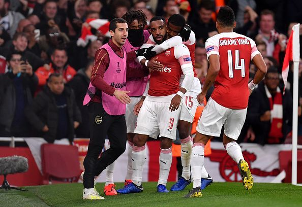 Lacazette wheels away to celebrate one of his two goals - though he should have had more