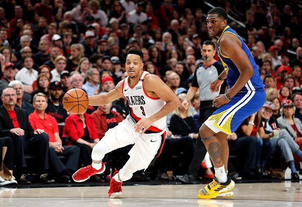 6ba43ac1a1cb CJ McCollum (left) in action against Kevon Looney and the Golden State  Warriors during