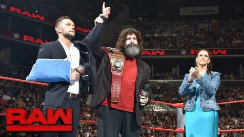 Balor with Foley and Stephanie