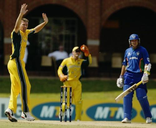 Glenn McGrath of Australia claims the wicket of Morne Karg of Namibia