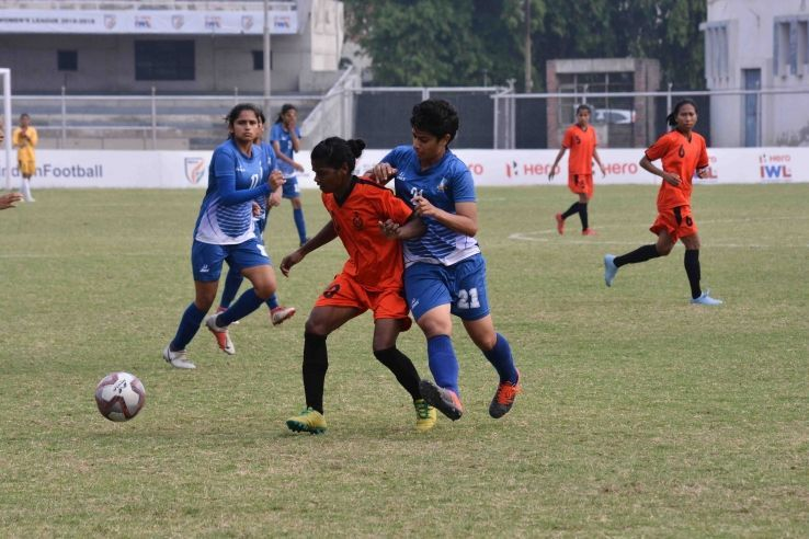 Dular Marandi (left) of SSB Women in a tussle for possession with Jyotika of Hans Women FC during their IWL match