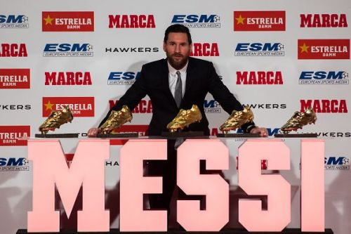Lionel Messi receiving the 2017-18 Golden Shoe award, his 5th so far