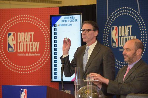 League executive VP Kiki VanDeWeghe held drawings for the NBA Draft tiebreakers on April 12.