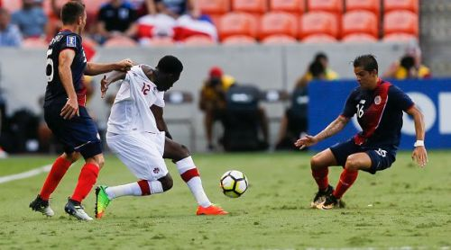 Alphonso Davies in action for Canada (middle)