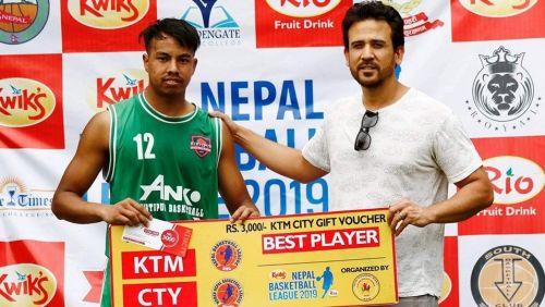 Anil Khadgi (L) of Kirtipur Basketball Club was declared Man of the Match