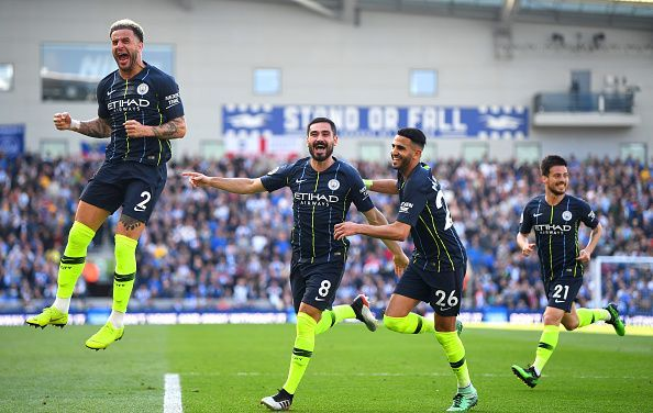 Walker, Gundogan, Mahrez and D. Silva celebrate Ilkay's free-kick strike as they clinched the title