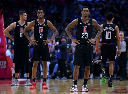 Dejected Los Angeles Clippers players after getting ousted by the Golden State Warriors