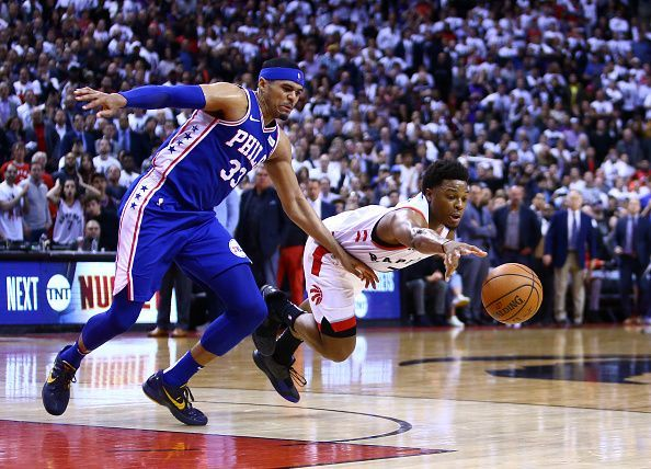 Tobias Harris and Kyle Lowry fighting for the ball