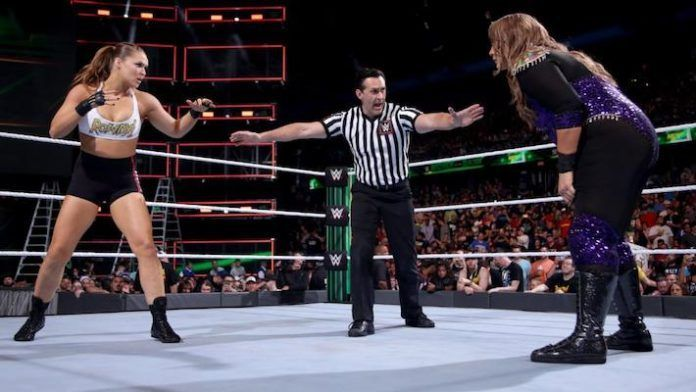 Ronda Rousey was knocked out of the ring by Nia Jax