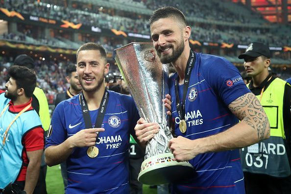 Matchwinners Hazard and Giroud celebrate with the Europa League trophy aloft