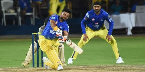 EYES TRANSFIXED ON THE BALL: Harbhajan Singh watches on as Raina lofts the ball over mid on in a practice match for the Chennai Super Kings