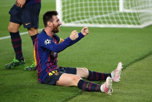 Messi celebrates a stunning free kick against Liverpool at Camp Nou.