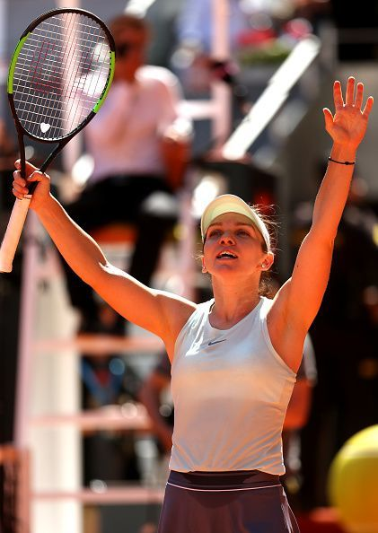 Simona Halep waves the fans after her three set win over Belinda Bencic at the Mutua Madrid Open