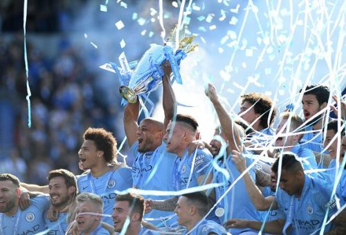 Vincent Kompany lifts the English Premier League trophy with typical emotion