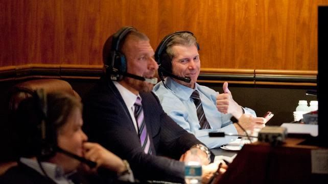 Vince McMahon (far right) and Triple H (center)